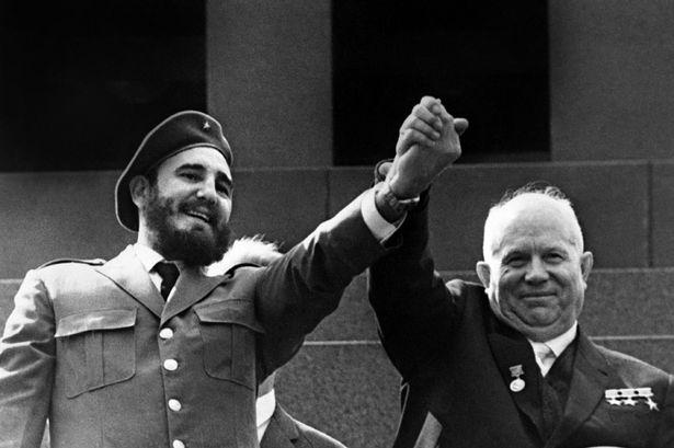 Fidel Castro holding the hand of Soviet leader Nikita Khrushchev-1375387